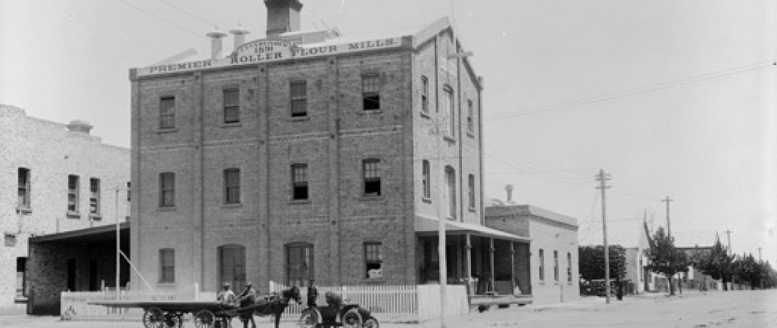The Premier Roller Flour Mills in Katanning circa 1903. This historical photograph shows the Mill a decade after opening remained largely unchanged, here a horse and cart is stationed outside of the Mill on what is now Austral Terrace in the town of Katanning.