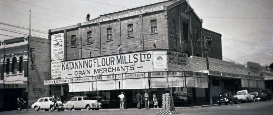 In the 1930's an addition of shops fronting the Mill allowed locals to purchase more than just flour when they visited the mill. This photo shows the front of the Premier Flour Mill and it's changing signage with the addition of 'The Wattle' cafe on the Austral Terrace side.